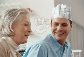 Grown Man in Party Hat with His Mother